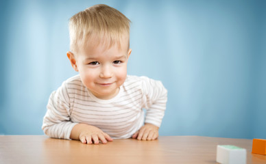 Portrait of a two years old child sitting at the table