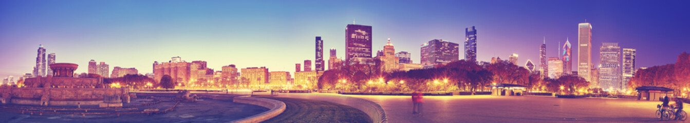 Color toned panoramic picture of Chicago downtown at twilight, long exposure, USA.