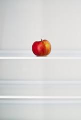 Apple in an empty fridge