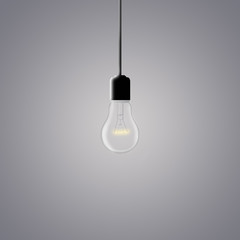 glowing light bulb on a dark gray background