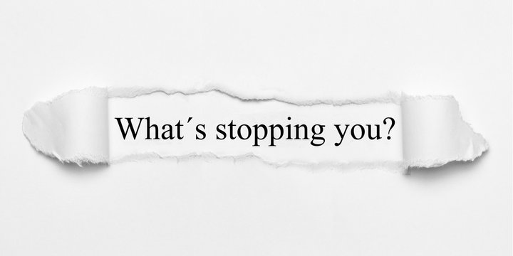 What´s stopping you? on white torn paper