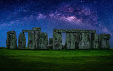 Landscape image of Milky way galaxy at night sky with stars over Stonehenge an ancient prehistoric stone monument, Wiltshire, UK.