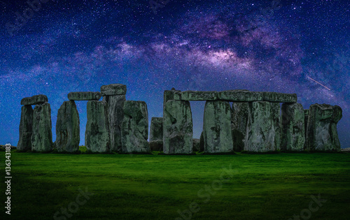 Wall mural Landscape image of Milky way galaxy at night sky with stars over Stonehenge an ancient prehistoric stone monument, Wiltshire, UK.