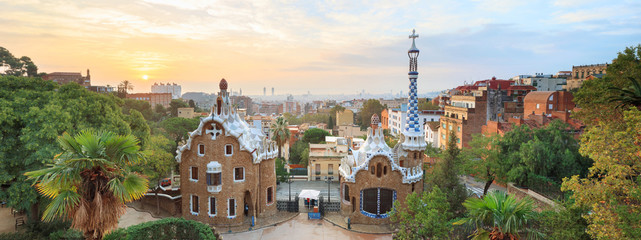 Self adhesive Wall Murals Barcelona Park Guell in Barcelona. View to entrace houses with mosaics on foreground