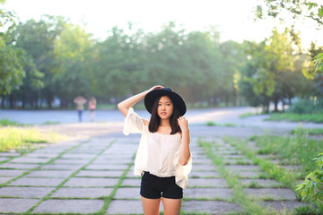 wonderful female hat asian sunset cheerful emotions laughter dancing