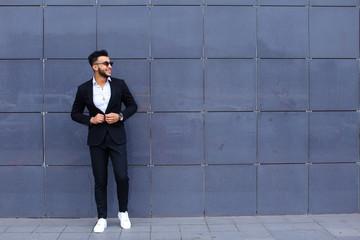Garden Poster Fantasy Landscape Arabic guy in business center stands smiling walking slow