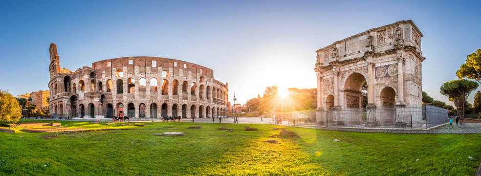 Panoramic view of Colosseum and Constantine arch at sunrise. Rome, Italy