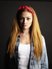 Girl with red hair with funny grimace