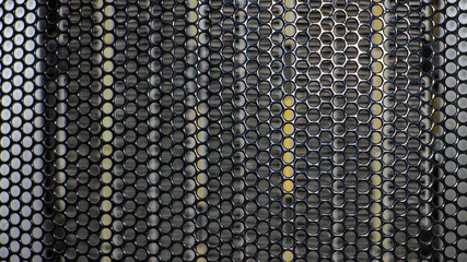 A metal grid. Abstract background texture with circular holes