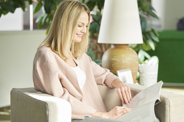 Imagining all the possibilities. Mature woman reading a magazine while relaxing at home