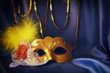 gold venetian mask on blue silk background