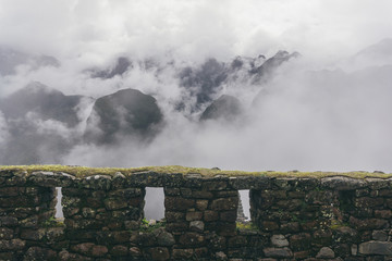 High angle view fortified walls against mountains at machu picchu during foggy weather