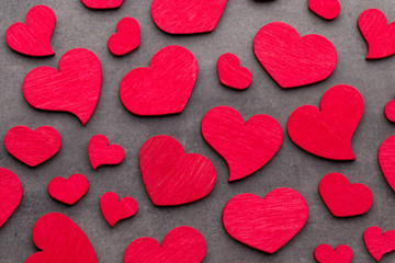 Red hearts on the wooden background.