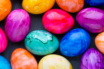 Easter eggs painted in colors on a pattern background.
