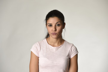 beautiful arrogant and moody spanish woman showing negative feeling and contempt facial expression