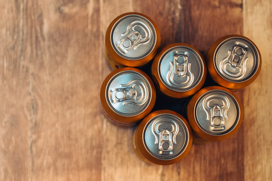 Beer cans on rustic wooden table top view