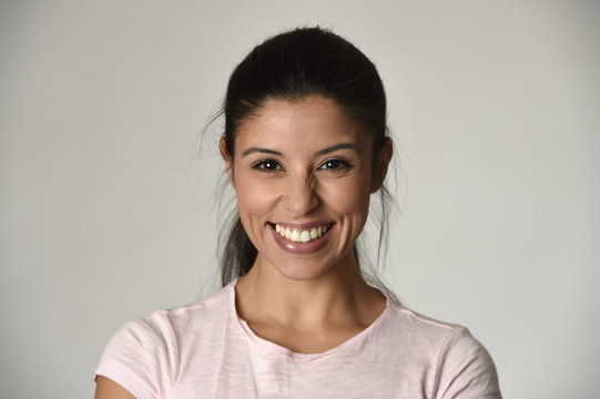 portrait of young beautiful and happy Latin woman with big toothy smile excited and cheerful