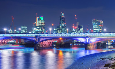 City of London skyline by the River Thames at night