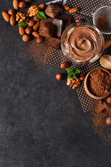 Acrylic Prints Dessert Black food background with cocoa, nuts and chocolate paste.