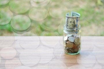 Dollar coin and banknote cash saving in glass jar, finance saving concept, double exposure