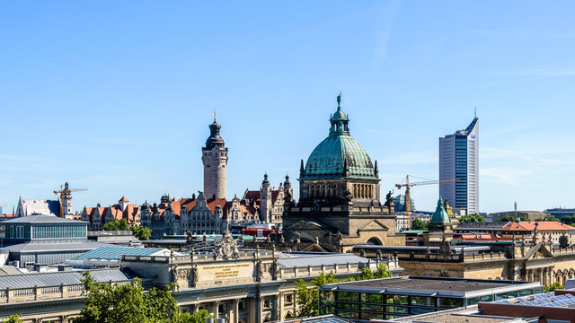 panoramic skyline of Leipzig with townhall and high court at sunset, Germany