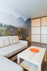 The interior of the living room in orange tones with a coffee table and sofa