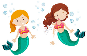 Two cute mermaid swimming underwater