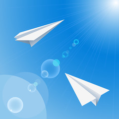 Background with paper origami planes flying in the sky.