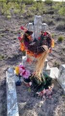 Cross Headstone with a Flowery Wreath