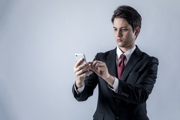 young businessman looking a smart phone