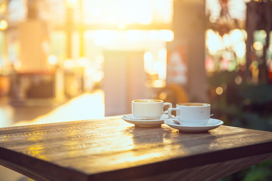 coffee in the morning, two cup of espresso on wood table in cafe or coffeeshop.