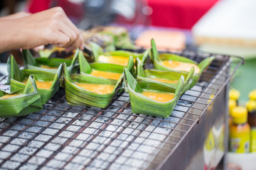 Kai-Pam or Grilled egg on banana leaf cup Thailand northern food.