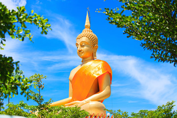 Huge Beautiful Golden Buddha Statue with Blue sky in Thailand