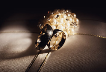 Precious wedding rings in the dark room