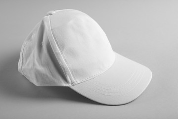 Blank baseball cap on grey background
