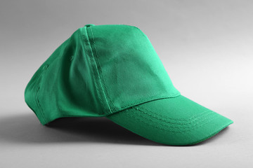 Blank green baseball cap on grey background