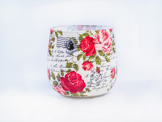 Picture of the decoupage cup isolated on white background. Handmade decoupage cup close up. Red flowers decoupage pattern.