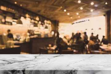 Stone table top and blurred bokeh cafe and coffee shop interior