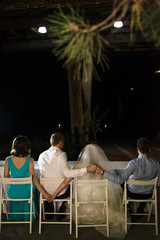 bride, groom and friends together in the evening restaurant