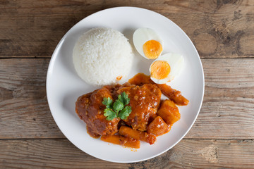 Chicken stew with sauce tomato and egg, rice. Top view.