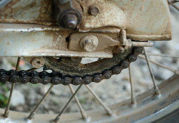Old and dirty rusted chain on old motorcycle