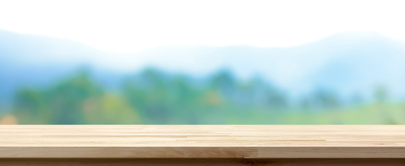 Wood table top on blur green forest and mountain background, panoramic banner