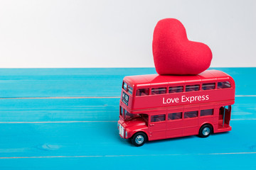 Love express on sightseeing bus with carrying red heart on roof for valentine's day and copy space for text. Valentine's day holiday concept.