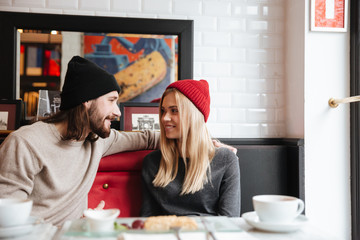 Happy Couple sitting together in cafe