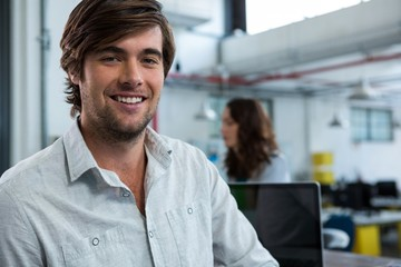 Businessman smiling at camera
