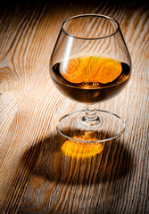 Wall Mural - Whiskey or brandy on a wooden table
