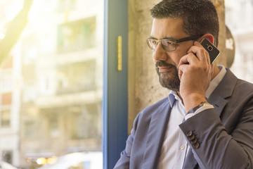 Man talking on mobile phone in restaurant