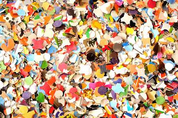 Carnival background, colored confetti, top view