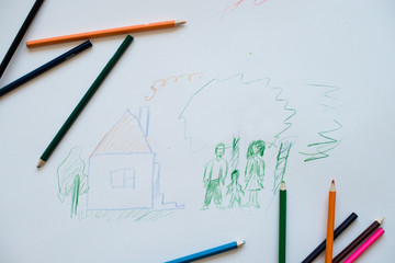 child's drawing with colored pencils family and  house