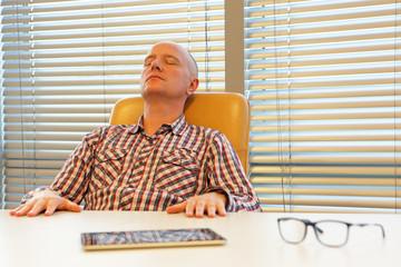 middle age balding man  relaxing in office - short break for regeneration